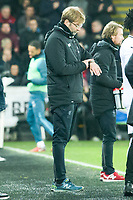 Football - 2017 / 2018 Premier League - Swansea City vs. Liverpool<br /> <br /> Liverpool manager Jurgen Klopp looks at his watch as his team fail to equalise , at The Liberty Stadium.<br /> <br /> COLORSPORT/WINSTON BYNORTH