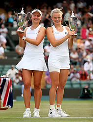 Katerina Siniakova (right) and Barbora Krejcikova with their trophies after winning the Ladies Doubles on day twelve of the Wimbledon Championships at the All England Lawn Tennis and Croquet Club, Wimbledon. PRESS ASSOCIATION Photo. Picture date: Saturday July 14, 2018. See PA story TENNIS Wimbledon. Photo credit should read: Nigel French/PA Wire. RESTRICTIONS: Editorial use only. No commercial use without prior written consent of the AELTC. Still image use only - no moving images to emulate broadcast. No superimposing or removal of sponsor/ad logos. Call +44 (0)1158 447447 for further information.