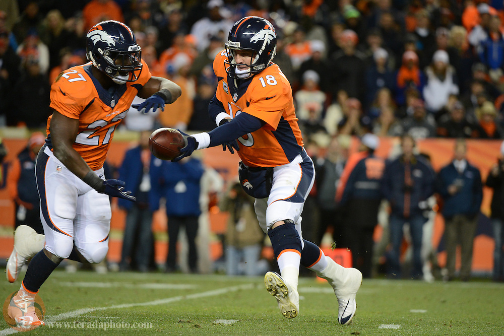 November 17, 2013; Denver, CO, USA; Denver Broncos quarterback Peyton Manning (18) hands the football to running back Knowshon Moreno (27) during the first quarter against the Kansas City Chiefs at Sports Authority Field at Mile High. The Broncos defeated the Chiefs 27-17.
