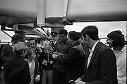 Muhammad Ali In Dublin..1972..11.07.1972..07.11.1972..11th July 1972..Prior to his fight against Al 'Blue' Lewis at Croke Park ,Dublin, former World Heavyweight Champion,Muhammad Ali arrives at Dublin Airport..The fight was part of his build up for for a championship fight against the current World Champion, 'Smokin'  Joe Frazier. Ali had been stripped of the title partly due to his refusal to join the American military during The Vietnam War,which he had opposed...Photo of Muhammad Ali signing his autograph for a workman as other fans gather round.