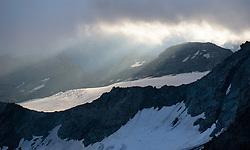THEMENBILD - Großglockner im Sommer. das Bild wurde am 12. August 2012 aufgenommen. im Bild Sonne bricht durch Wolken und scheint auf das Teischnitz Kees, davor der Luisengrat, der rechts in den Stüdlgrat übergehend // THEME IMAGE FEATURE - Großglockner at Summer. The image was taken on august, 12, 2012. Picture shows sunlight spotlights Teischnitzkees Glacier, AUT, EXPA Pictures © 2012, PhotoCredit: EXPA/ M. Gruber