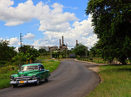 Old car and sugar mill in Hershey, Mayabeque, Cuba.