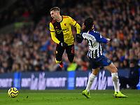 Football - 2019 / 2020 Premier League - Brighton & Hove Albion vs. Watford<br /> <br /> Watford's Gerard Deulofeu is fouled by Brighton & Hove Albion's Ezequiel Schelotto, at the Amex Stadium.<br /> <br /> COLORSPORT/ASHLEY WESTERN