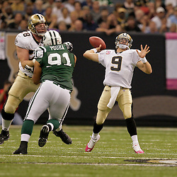 2009 October 04: New Orleans Saints quarterback Drew Brees (9) throws a deep pass during a 24-10 win by the New Orleans Saints over the New York Jets at the Louisiana Superdome in New Orleans, Louisiana.