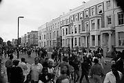 Crowd walking through a street, Notting Hill Carnival, London, 1989