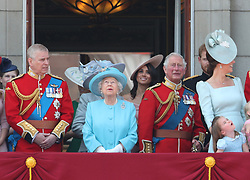 (left to right) The Duke of York, Duchess of Cornwall (hidden), Queen Elizabeth II, Duchess of Sussex, Prince of Wales, Duke of Sussex and the Duchess of Cambridge with Princess Charlotte, on the balcony of Buckingham Palace, in central London, following the Trooping the Colour ceremony at Horse Guards Parade as the Queen celebrates her official birthday.