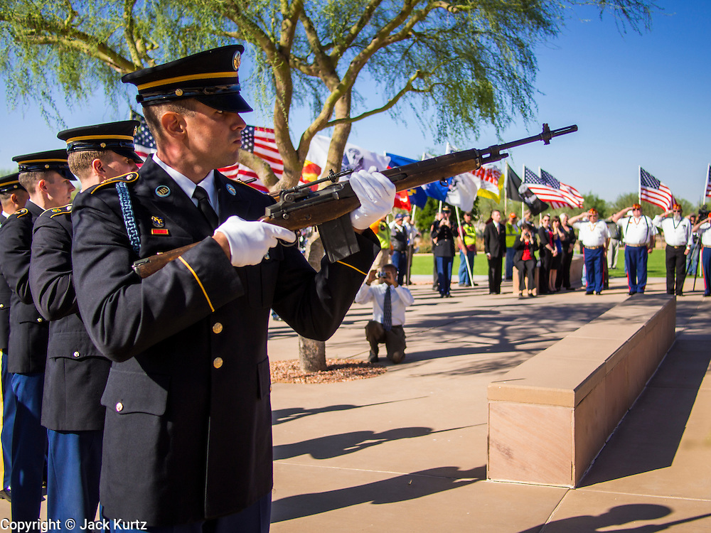 08 OCTOBER 2013 - PHOENIX, AZ: A US Army rifle salute at a ceremony for unclaimed US military veterans in Phoenix. The cremated remains of 36 unclaimed US military veterans were interred at the National Memorial Cemetery in Phoenix. Members of the US military and several hundred veterans of the US military attended the service, which was a part of the Missing In America Project (MIAP).     PHOTO BY JACK KURTZ