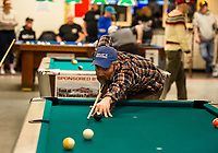 Daniel Brothers lines up a shot during the Robbie Mills 8-Ball Tournament at the Rod and Gun on Saturday afternoon.  (Karen Bobotas/for the Laconia Daily Sun)