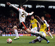 James Husband getting fouled for the penalty during the Sky Bet Championship match between Fulham and Brentford at Craven Cottage, London, England on 3 April 2015. Photo by Matthew Redman.