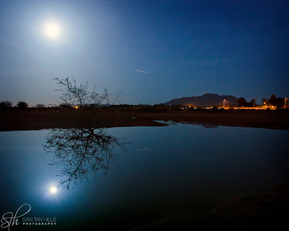"A rare ""super moon"" reflecting in a pond at Veteran's Memorial Park - Chandler, AZ"