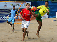 07 December 2006, Brazil's Benjamin da Silva and England's James Temple contest for the ball during the first game of the Vodacom Pro Beach Soccer Tour at Durban's Bay of Plenty on Thursday. Brazil won the game 10 - 3. Picture: Shayne Robinson, PhotoWire Africa