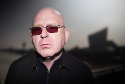 © Licensed to London News Pictures . 19/03/2015 . Salford Quays , UK . ALAN MCGEE at Salford Quays . Black Grape photocall at The Green , Salford Quays , Greater Manchester . Black Grape are reforming for a Madchester charity gig along with other local bands , to raise awareness for Bez's Reality Party and anti-fracking . Photo credit : Joel Goodman/LNP