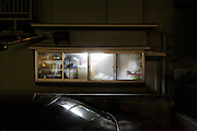 from inside lighted up window of an old residential house Japan
