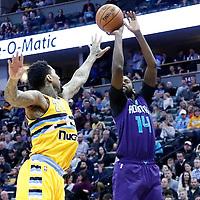 04 March 2017: Charlotte Hornets forward Michael Kidd-Gilchrist (14) takes a jump shot over Denver Nuggets forward Wilson Chandler (21) during the Charlotte Hornets 112-102 victory over the Denver Nuggets, at the Pepsi Center, Denver, Colorado, USA.