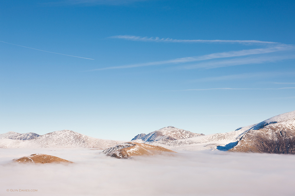 A phenomenal temperature inversion in North Wales, leaving only the summits of Snowdonia's highest peaks in glaring sunshine above the cloud bank.  <br /> <br /> Tryfan &amp; the Glyderau are the high peaks in the background and Yr Wyddfa (Snowdon) fill the foreground above the fog