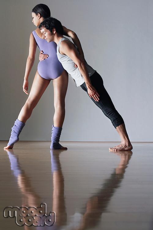 Ballet dancer leaning against ballerina