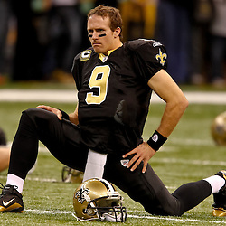 November 21, 2010; New Orleans, LA, USA; New Orleans Saints quarterback Drew Brees (9) during warm ups prior to kickoff of a game against the Seattle Seahawks at the Louisiana Superdome. The Saints defeated the Seahawks 34-19. Mandatory Credit: Derick E. Hingle
