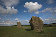 Standing stones at Newgrange, a 5000 year old passage tomb in Co. Meath, Ireland. Airliner contrail overhead.