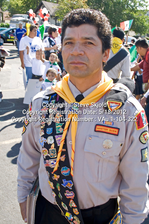 Mexican American Boy Scout Leader wearing sash of merit badges at parade. Mexican Independence Day Minneapolis Minnesota MN USA