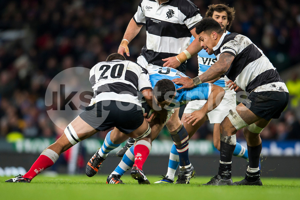 Santiago Iglesias Valdez of Argentina runs hard into Jerrad Butler of The Barbarians during the Killik Cup match between Barbarians and Argentina at Twickenham Stadium, Twickenham, United Kingdom on 21 November 2015. Photo by Brandon Griffiths.