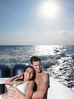 Young couple on speedboat