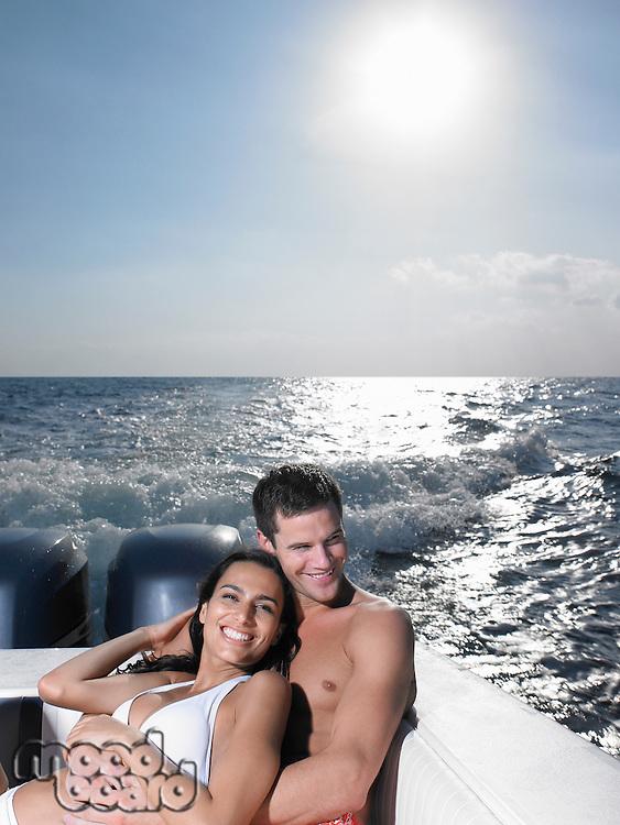 Young couple on speedboat
