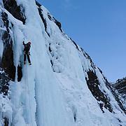 """Skarphéðinn Halldórsson climbing """" Gredda nærri banvæn """" FA. WI4+, 90m. Tröllhamrar, Breiðdalur, Iceland."""