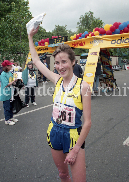 1998 Women's Mini Marathon sponsored by the Evening Herald, 7/6/98..<br /> Catherina McKiernan at the finish line in first place.<br /> (Part of the Independent Newspapers Ireland/NLI Collection).