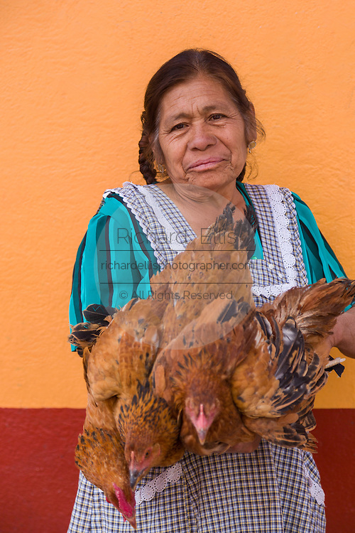 A woman selling lives chickens at the Sunday market in Tlacolula de Matamoros, Mexico. The regional street market draws thousands of sellers and shoppers from throughout the Valles Centrales de Oaxaca.