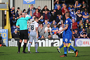 Northampton Town defender Aaron Phillips (18) yellow card during the EFL Sky Bet League 1 match between AFC Wimbledon and Northampton Town at the Cherry Red Records Stadium, Kingston, England on 11 March 2017. Photo by Matthew Redman.