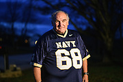 """Highland, Maryland - December 03, 2018: Unbeknownst to him, fifty-four-years-ago, a bet was placed on Naval Academy cadet Greg Horne's benefit, while he was recovering from an injury. Navy lost to Army and he owed Ed Dewey, a West Point cadet, a USNA parka. <br /> <br /> Ed even sent a follow-up letter asking Greg to """"pay-up."""" -- but Greg was at sea, and his mail was forwarded to his mother's home. He found the then 52-year-old letter, while he and his siblings cleaned out their late mother's house in 2016. It took some time, but Greg tracked down Ed. <br /> <br /> The parkas are not longer made, so to make good on his bet, he sent Ed a commemorative USNA blanket, similar to one he owns. <br /> <br /> CREDIT: Matt Roth for The New York Times<br /> Assignment ID: 30228001A"""