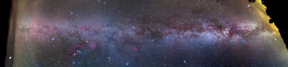 A panorama from Cygnus (at right, setting in the western sky in the evening), across the sky overhead in Perseus, Auriga and Taurus, and down into Orion, Canis Major, and Puppis (at left, low in the southern sky at midnight). This panorama covers about 200&deg; of galactic longitude, from 60&deg; in Cygnus to 260&deg; in Puppis and takes in the entire northern swath of the Milky Way visible in autumn and early winter in the northern hemisphere, from the summer Milky Way at right to the winter Milky Way at left. <br /> <br /> Orion is at lower left, while the Pleiades and Andromeda Galaxy lie near the bottom edge. Canopus is the bright star just rising at far left, in haze. Vega and Altair are just setting at far right. <br /> <br /> The view here is looking outward to the near edge of the Milky Way, in the direction opposite the centre of the Galaxy. In this direction the Milky Way becomes dimmer and less defined. Notable are the many red H-alpha emission regions along the Milky Way, as well as the many lanes of dark interstellar dust nearby and obscuring the more distant stars. However, a brighter glow in Taurus partly obscures its Taurus Dark Clouds &mdash; that&rsquo;s the Gegenschein, caused by sunlight reflecting off cometary dust particles directly opposite the Sun and marking the anti-solar point this night, by coincidence close to galactic longitude of 180&deg; opposite the galactic centre. <br /> <br /> This is a panorama of 14 segments, most composed of 5 x 2.5-minute exposures with the filter-modified Canon 5D MkII at ISO 1600 and 35mm lens at f/2.8. The end segments near the horizon are stacks of 2 x 2.5-minute exposures. The camera was oriented with the long dimension of the frame across the Milky Way, not along it, to maximize the amount of sky framed on either side of the Milky Way. <br /> <br /> The camera was on the iOptron Sky-Tracker. I shot the segements for his pan from Quailway Cottage, Arizona on December 8/9, 2015, with the end segments taken