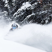 Hadley Hammer skiing powder in the Teton backcountry.