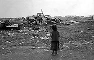 Rome 1999.A Child roma bosnian, who lives in the Rom's camp  Casilino 700, looks at his house destroyed by the bulldozers of the municipality of Rome..Roma  1999.Una bambina rom bosniaca,che vive al campo rom di Casilino 700, guarda la sua abitazione  distrutta dalle ruspe del comune di Roma.