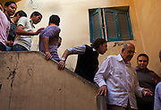 Egyptian Nobel Peace laureate and former UN atomic watchdog chief, Mohamed ElBaradei (C), is followed down a staircase by young supporters and political bloggers during a brief stop in the Egyptian delta town of Aga on April 2, 2010. ElBaradei is thought to be a possible candidate to run against Egyptian President Hosni Mubarak in the 2011 presidential election, although he has not made a formal declaration as of yet.