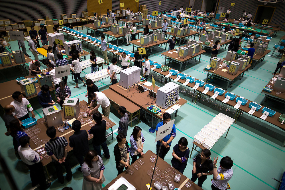 TOKYO, JAPAN - JULY 10 : Election staff members waiting for more ballot boxes to arrive before the official count of votes for the Parliament's upper house elections at a ballot counting center in Shinjuku Cosmic Sports Center in Shinjuku-ku on Sunday, July 10, 2016 in Tokyo, Japan. (Photo by Richard Atrero de Guzman/NUR Photo)