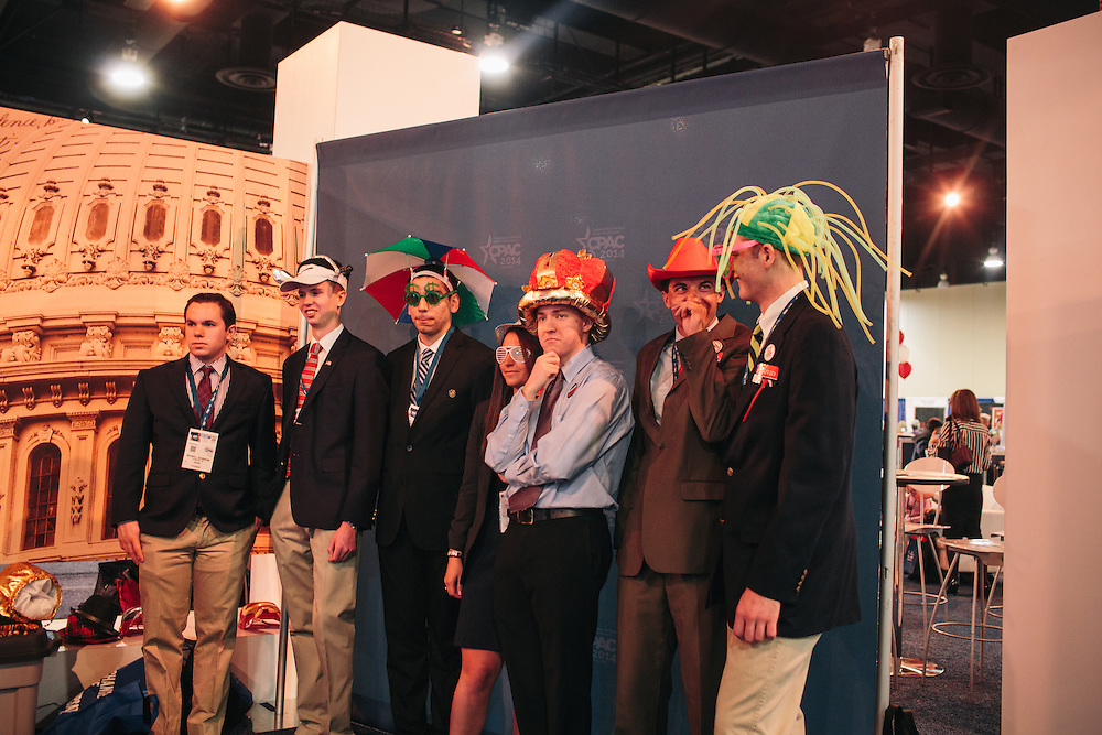 Max Shanbrom, 19, from left, Ryan McAvoy, 18, Ann Tumolo, 20, Chris Cornell, 19, Ryan Smith, 21, Matt Masino, 18, and Noah Hunsinger, 20, members of Loyola University Maryland College Republicans, take part in a photo booth during day two of the Conservative Political Action Conference (CPAC) at the Gaylord National Resort & Convention Center in National Harbor, Md.
