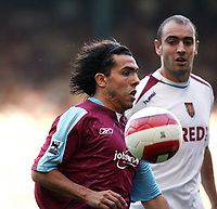 Photo: Chris Ratcliffe.<br /> West Ham United v Aston Villa. The Barclays Premiership. 10/09/2006.<br /> Carlos Tevez of West Ham controls the ball under pressure from Gavin McCann.