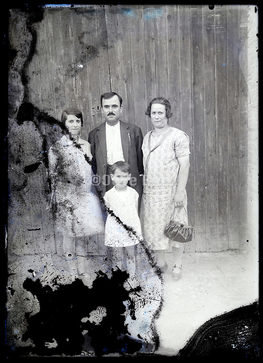 eroding glass plate photo of a family group portrait