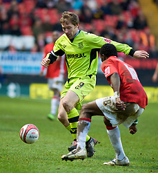 LONDON, ENGLAND - Saturday, January 30, 2010: Charlton Athletic's Sam Sodje marks Tranmere Rovers' Ian Moore closely during the Football League One match at the Valley. (Photo by Gareth Davies/Propaganda)