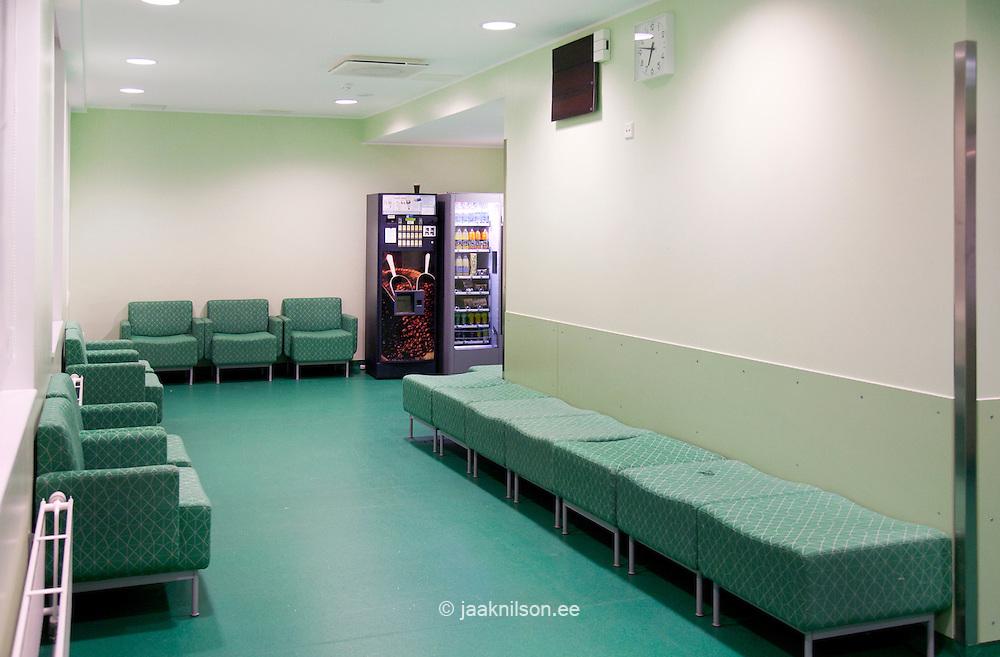 Tartu University Hospital in Estonia, corridor, seating and waiting area. Drinks and food vending machines.