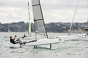 Blair Tuke (NZL265) foils to the finish of race one of the A Class World championships regatta being sailed at Takapuna in Auckland. 11/2/2014