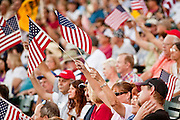 "May 29 - TEMPE, AZ: People wave American flags during a rally against illegal immigration in Tempe, AZ, Saturday. About 3,000 people attended a ""Buy Cott Arizona"" rally at Tempe Diablo Stadium in Tempe, AZ Saturday night. The rally was organized by members of the Arizona Tea Party movement to show support for Arizona law SB1070. The ""Buy Cott"" is a reaction to the economic boycott planned by opponents of SB1070. SB1070 makes it an Arizona state crime to be in the US illegally and requires that immigrants carry papers with them at all times and present to law enforcement when asked to. Critics of the law say it will lead to racial profiling, harassment of Hispanics and usurps the federal role in immigration enforcement. Supporters of the law say it merely brings Arizona law into line with existing federal laws.  Photo by Jack Kurtz"