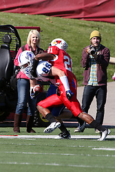 22 October 2011: Otis Merrill forces Michael Mardis out of bounds after Mardis catches a pass during an NCAA football game  the Indiana State Sycamores lost to the Illinois State Redbirds (ISU) 17-14 at Hancock Stadium in Normal Illinois.