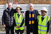 AFC Wimbledon legend Dave Bassett and AFC Wimbledon legend Ian Cooke with children from Smallwood Primary School during the AFC Wimbledon Demolition Event, marking the start of building works at the AFC Wimbledon Stadium Site, Plough Lane, United Kingdom on 16 March 2018. Picture by Stephen Wright.