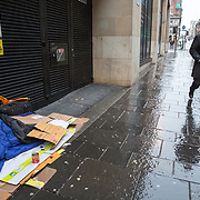 Homeless people sleeping on streets of Glasgow. A person lies sleeping in a doorway on Hope Street, Glasgow. <br /> <br /> Picture Robert Perry 17th March 2017<br /> <br /> Must credit photo to Robert Perry<br /> FEE PAYABLE FOR REPRO USE<br /> FEE PAYABLE FOR ALL INTERNET USE<br /> www.robertperry.co.uk<br /> NB -This image is not to be distributed without the prior consent of the copyright holder.<br /> in using this image you agree to abide by terms and conditions as stated in this caption.<br /> All monies payable to Robert Perry<br /> <br /> (PLEASE DO NOT REMOVE THIS CAPTION)<br /> This image is intended for Editorial use (e.g. news). Any commercial or promotional use requires additional clearance. <br /> Copyright 2014 All rights protected.<br /> first use only<br /> contact details<br /> Robert Perry     <br /> 07702 631 477<br /> robertperryphotos@gmail.com<br /> no internet usage without prior consent.         <br /> Robert Perry reserves the right to pursue unauthorised use of this image . If you violate my intellectual property you may be liable for  damages, loss of income, and profits you derive from the use of this image.