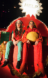 """© Licensed to London News Pictures. 14/12/2011. London, UK. Performers: Rebecca Fuller and Louise Mothersole. Theatre collective """"Duckie"""" returns to the Barbican for their """"Copyright Christmas"""" promenade performance show (10 to 31 December 2011). With capitalism collapsing and the criminal economy taking over, there has never been a better time to go shopping to witness the decaying arcades of branded Britain. Photo credit: Bettina Strenske/LNP"""