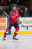 KELOWNA, CANADA - MARCH 15: Madison Bowey #4 of the Kelowna Rockets warms up against the Vancouver Giants on March 15, 2014 at Prospera Place in Kelowna, British Columbia, Canada.   (Photo by Marissa Baecker/Getty Images)  *** Local Caption *** Madison Bowey;