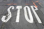 worn stop signal on an damaged asphalt road