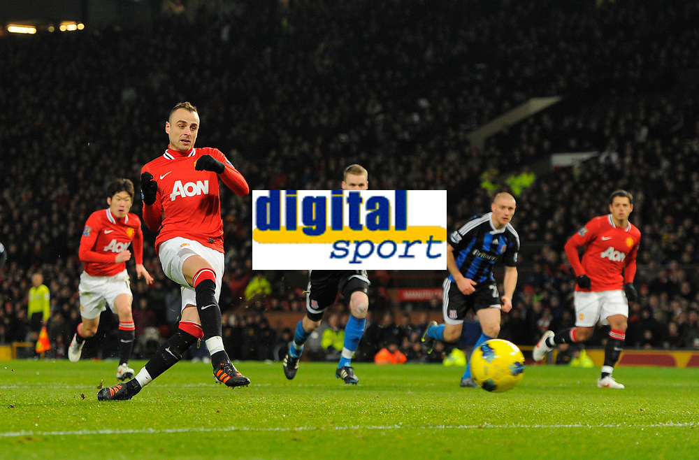 20120131: MANCHESTER, UK - Barclays Premier League 2011/2012: Manchester United vs Stoke City.<br /> In photo: Dimitar Berbatov of Manchester United scores from the penalty spot for the second goal.<br /> PHOTO: CITYFILES
